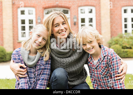Portrait of mother with two children - Stock Photo