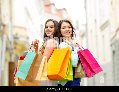 beautiful women with shopping bags in the ctiy - Stock Photo