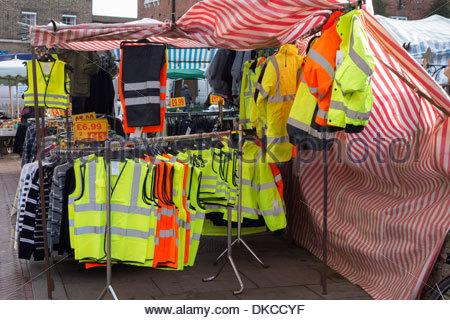 High visibility jackets for sale on racks on Huntingdon market - Stock Photo