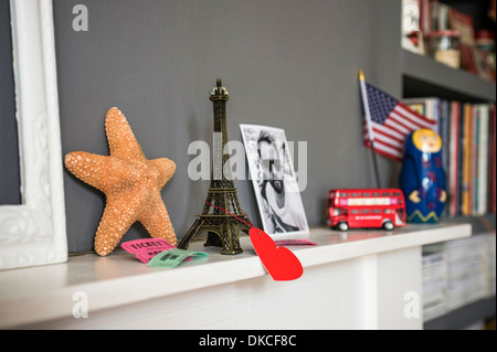 Living room mantelpiece with travel souvenirs - Stock Photo