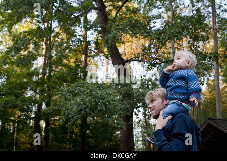 Little boy on father's shoulders - Stock Photo
