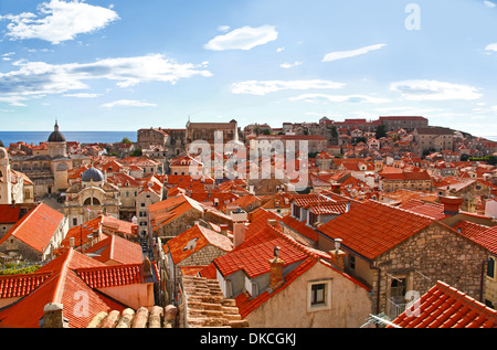 View of many landmarks of Old town in city of Dubrovnik, Croatia. Classic red tiled rooftops also are beautiful. - Stock Photo