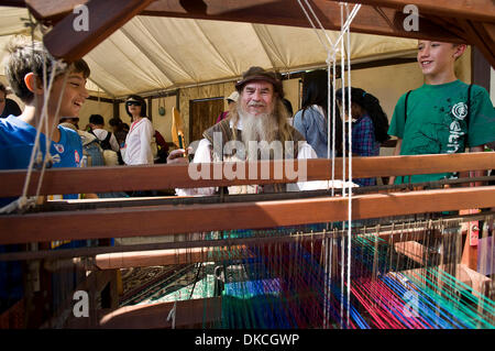 Oct. 21, 2011 - Poway, California, USA -  School children learn about the art of weaving on a loom at the Fifth - Stock Photo