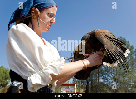 Oct. 21, 2011 - Poway, California, USA -  Andrea Ashbaugh feeds her falcon a fresh rabbit leg as a reward during - Stock Photo