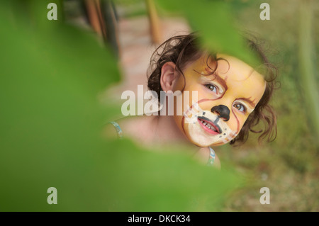 Girl with face painting of animal - Stock Photo