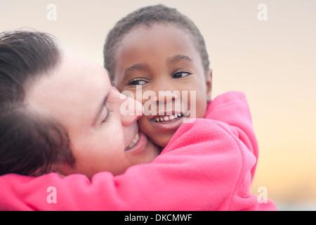 Man hugging child - Stock Photo
