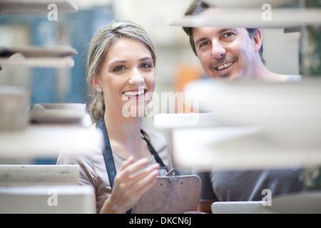 Potters at crockery factory - Stock Photo