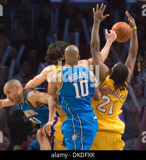 Jan 12, 2007; Los Angeles, CA, USA; Los Angeles Lakers' (21) RONNY TURIAF fights the ball against Orlando Magic's - Stock Photo