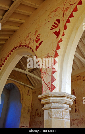 Wall painting detail between arches of the south aisle at the church of St Faith's at Little Witchingham, Norfolk, - Stock Photo