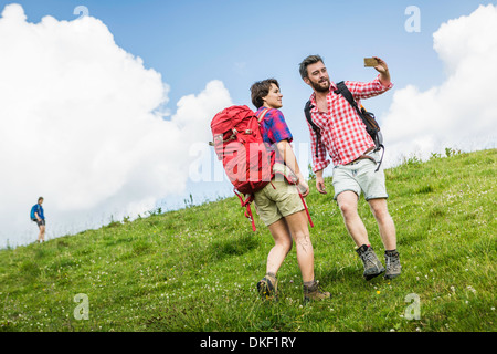 Young adults hiking, Tyrol, Austria - Stock Photo