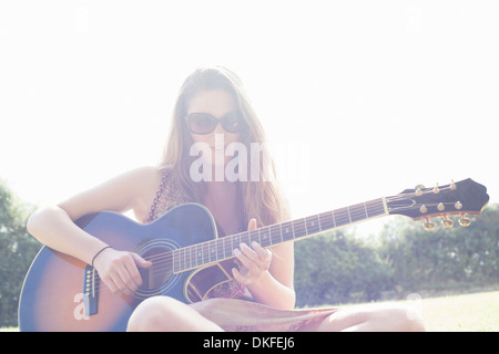 Teenager playing guitar - Stock Photo