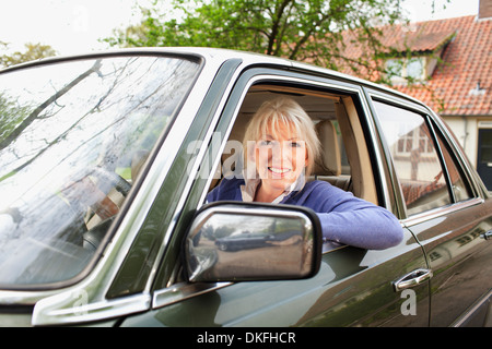 Portrait of mature woman in car - Stock Photo