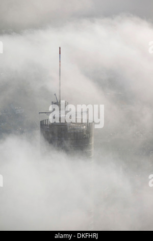 RWE Tower amidst the clouds, aerial view, Essen, Ruhr area, North Rhine-Westphalia, Germany - Stock Photo