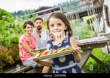 Young family preparing picnic lunch, Tyrol, Austria - Stock Photo