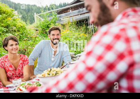 Group of friends having picnic lunch, Tyrol, Austria - Stock Photo