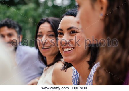 Young woman amongst family members - Stock Photo