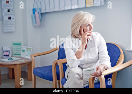 Mature female patient in hospital waiting room