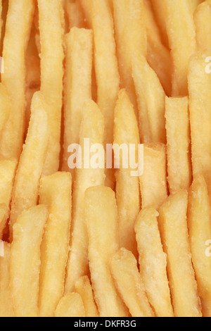 French fries in a row forming a fast food background - Stock Photo