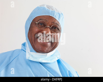 Surgeon wearing surgical scrubs and protective mask - Stock Photo