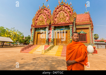 A young Buddhist monk at Wat (Phnom) Hanchey, on the Mekong River, Kampong Cham Province, Cambodia, Southeast Asia - Stock Photo