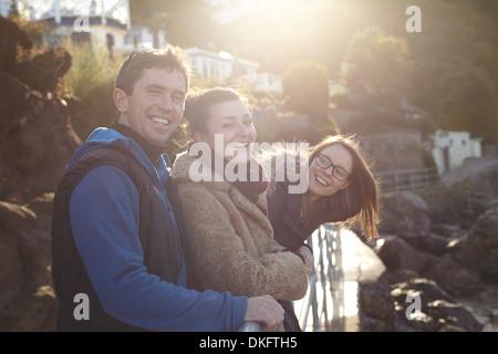 Friends on day trip in Devon, UK wearing winter clothing - Stock Photo