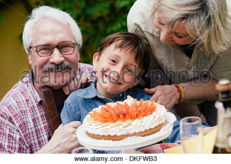 Boy with birthday cake from grandparents - Stock Photo