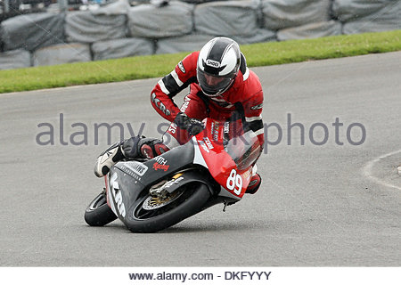 Wild Card entry, james Lodge crashes out in spectacular style on his KRP/Bradley Smith 125cc Honda causing the race - Stock Photo