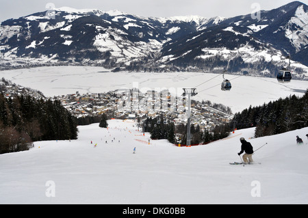Skiing down towards the resort of Zell am See, Austria - Stock Photo