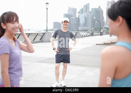Male and female joggers in city, Shanghai, China - Stock Photo