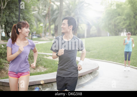 Young people running in park - Stock Photo