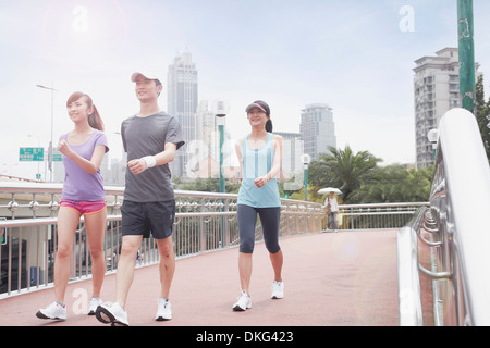 Young people walking in Shanghai, China - Stock Photo