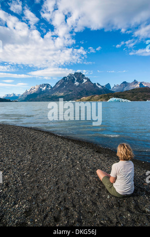 Woman enjoying Lago Grey lake in the Torres del Paine National Park, Patagonia, Chile, South America - Stock Photo