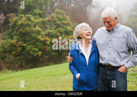 Husband and wife enjoying day out - Stock Photo