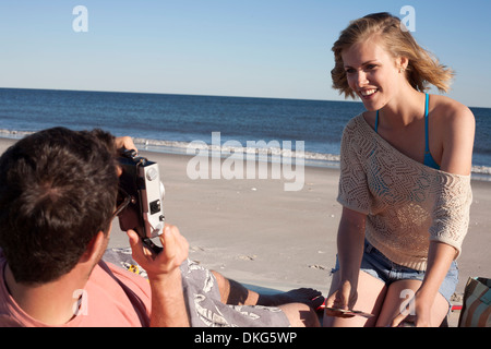 Couple photographing on beach, Breezy Point, Queens, New York, USA - Stock Photo
