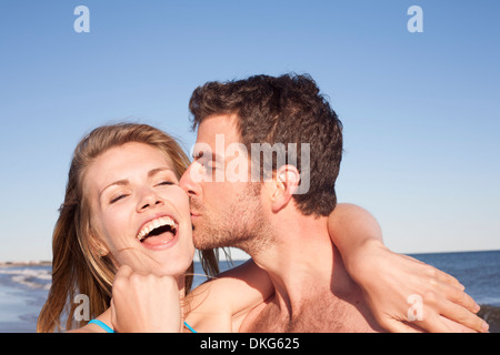 Close up portrait of couple on beach, Breezy Point, Queens, New York, USA - Stock Photo