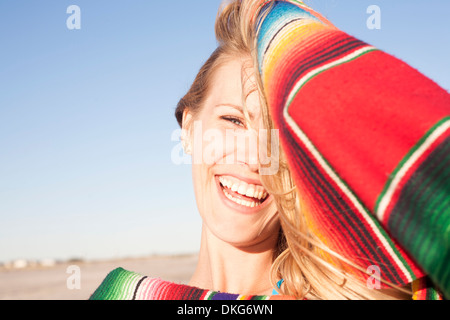 Portrait of young woman with blanket, Breezy Point, Queens, New York, USA - Stock Photo
