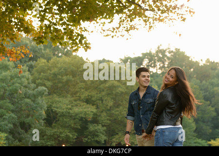 Young couple standing in park