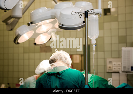 Team of surgeons at work in operating room - Stock Photo