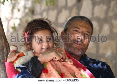 Turkish man and baby daughter in Halfeti, Sanliurfa province, south east Turkey - Stock Photo