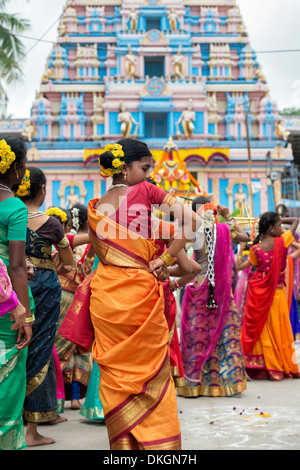 Indian girls in traditional dress dancing at a festival in the streets of Puttaparthi. Andhra Pradesh, India - Stock Photo