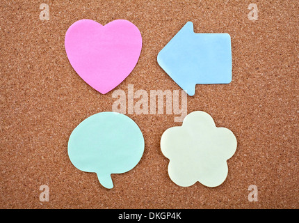 Four Different Sticky Notes on a Notice Board Texture. - Stock Photo