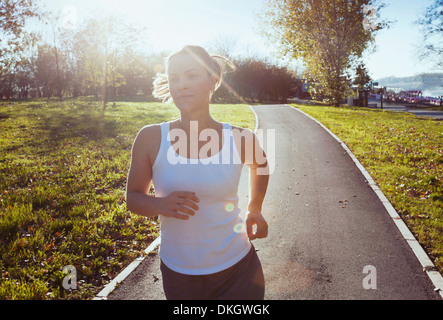 portrait of young running woman - Stock Photo