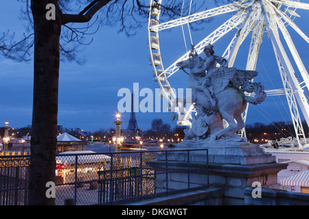 View from Place de la Concorde with big wheel and statue to the Eiffel Tower, Paris, Ile de France, France, Europe - Stock Photo