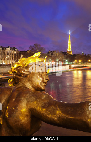 View from Pont Alexandre over River Seine to the Eiffel Tower at dusk, Paris, Ile de France, France, Europe - Stock Photo