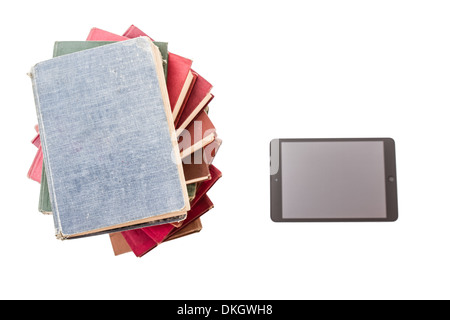 Pile of old books and tablet pc on white background - Stock Photo
