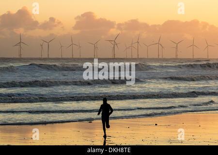 Jogger on Seaton Carew beach near Hartlepool, north east England. UK - Stock Photo