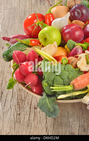 fresh fruits and vegetables on wooden table - Stock Photo