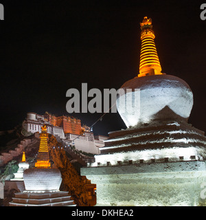 Low angle view of a stupa with Potala Palace in the background, Lhasa, Tibet, China - Stock Photo