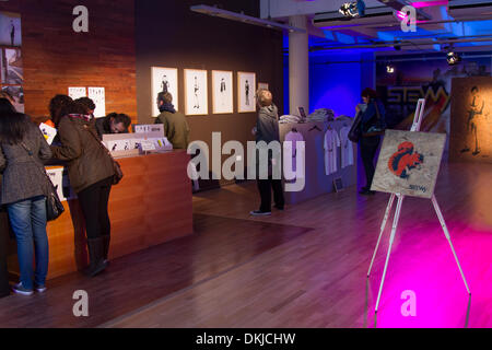 Manchester City UK.  6th December, 2013.  Visitors to Street Art exhibition at Deansgate, Manchester.  'Northern - Stock Photo
