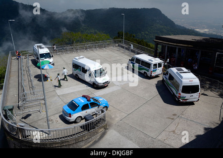 A fleet of tourist buses ferry visitors to and fro from the main car park at the Christ Redeemer in Rio de Janeiro, - Stock Photo